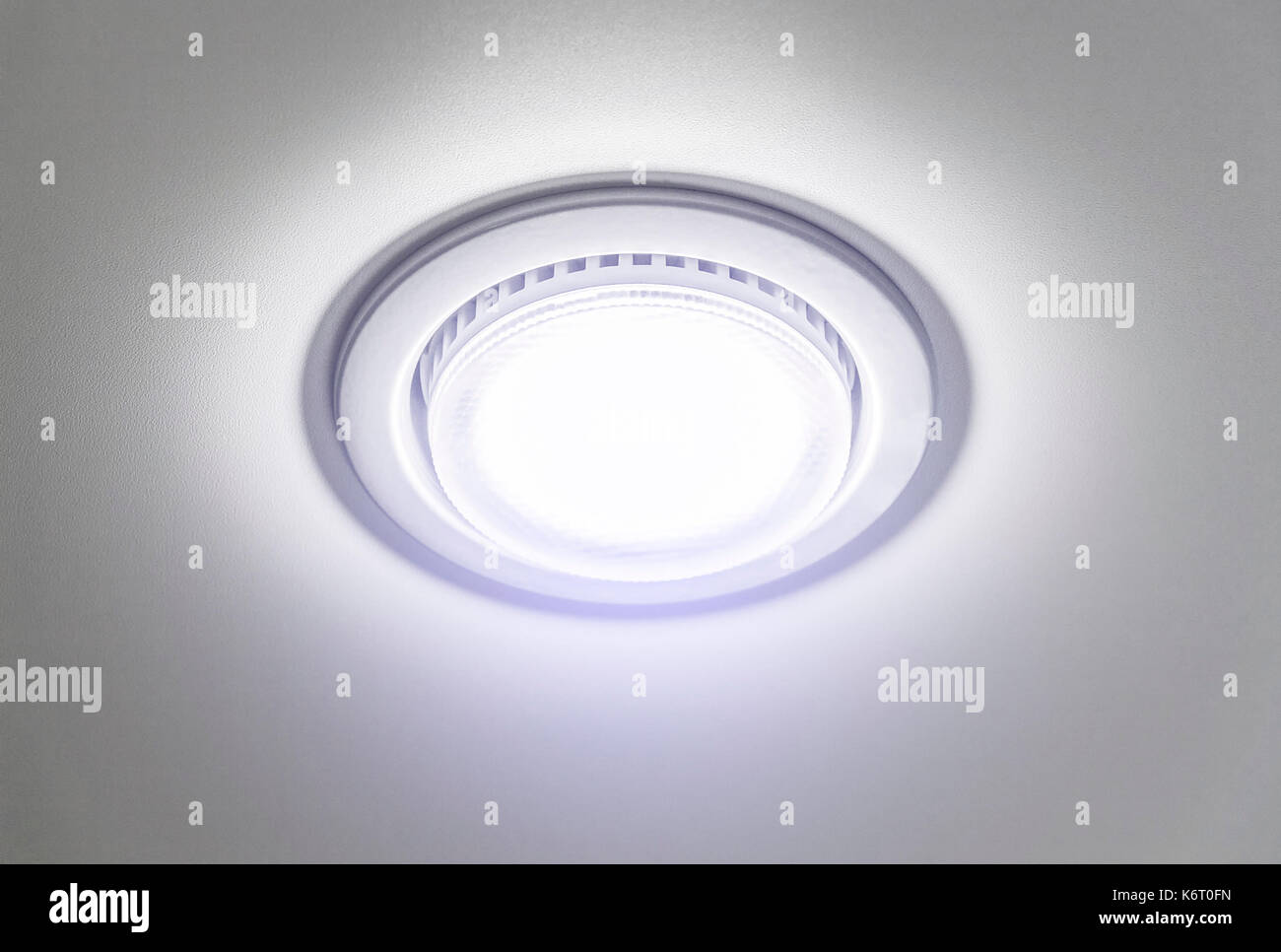 Ceiling recessed lamp close-up on a background of tension ceiling. - Stock Image