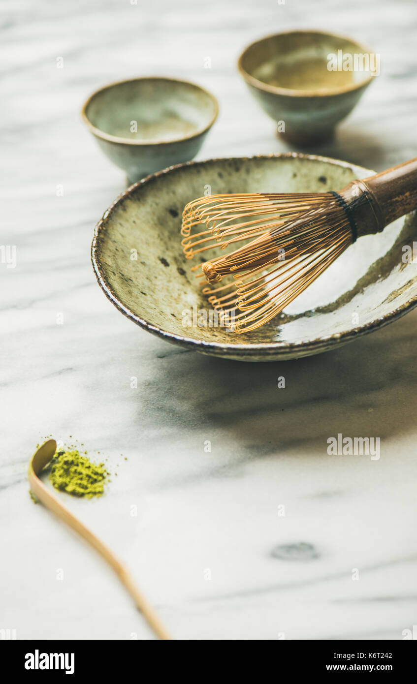 Japanese tools and bowls for brewing matcha tea, copy space - Stock Image