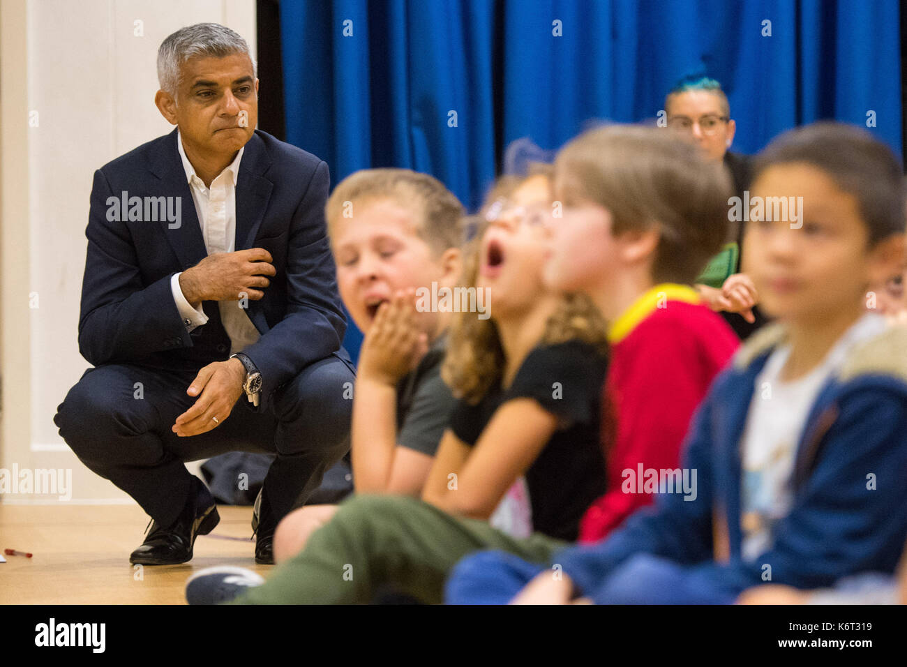 Mayor of London Sadiq Khan listens to a presentation as he launches the first of 50 'air quality audits' at Prior Weston Primary School in central London, which is located close to a busy road which has pollution levels that are twice the legal limit. - Stock Image