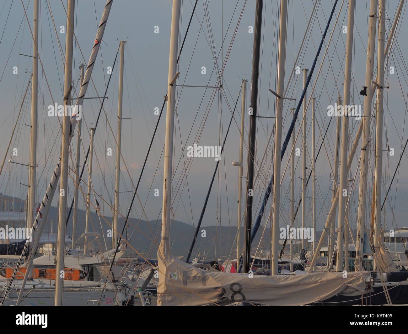 Saint-tropez, France - august 8 2017: A series of masts of multiple sailboats. - Stock Image