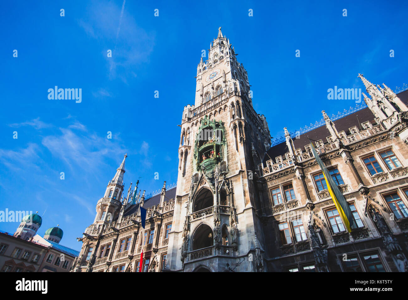 Beautiful super wide-angle sunny aerial view of Munich, Bayern, Germany with skyline and scenery beyond the city, seen from the observation deck of St - Stock Image