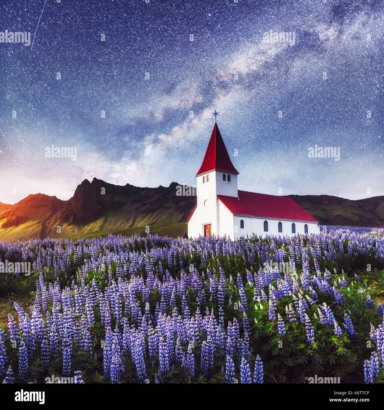 Beautiful collage Lutheran Church in Vik under fantastic starry sky. Iceland. - Stock Image