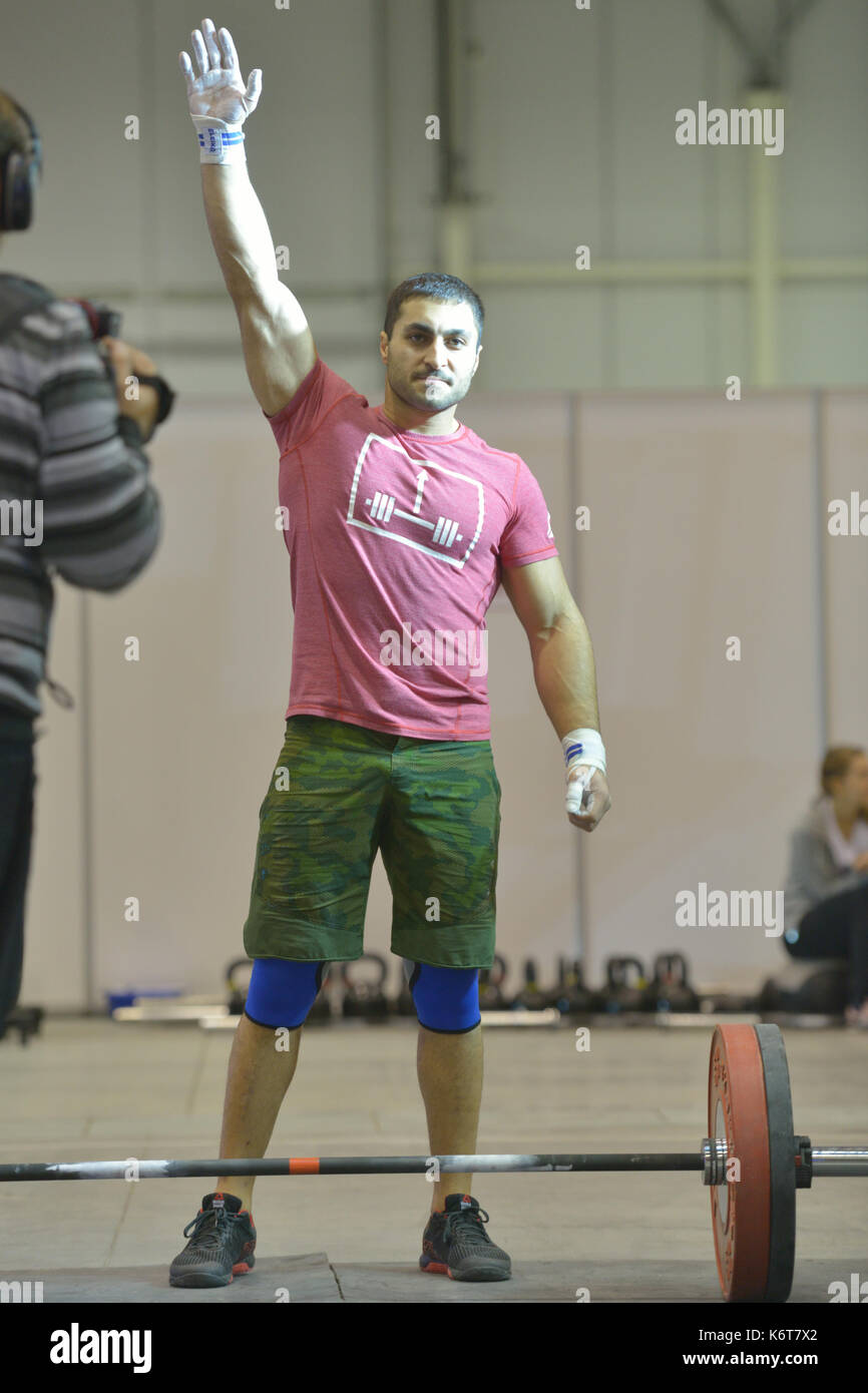 Novosibirsk, Russia - November 16, 2014: Unidentified athlete during the International crossfit competition Siberian Showdown. The competition include - Stock Image