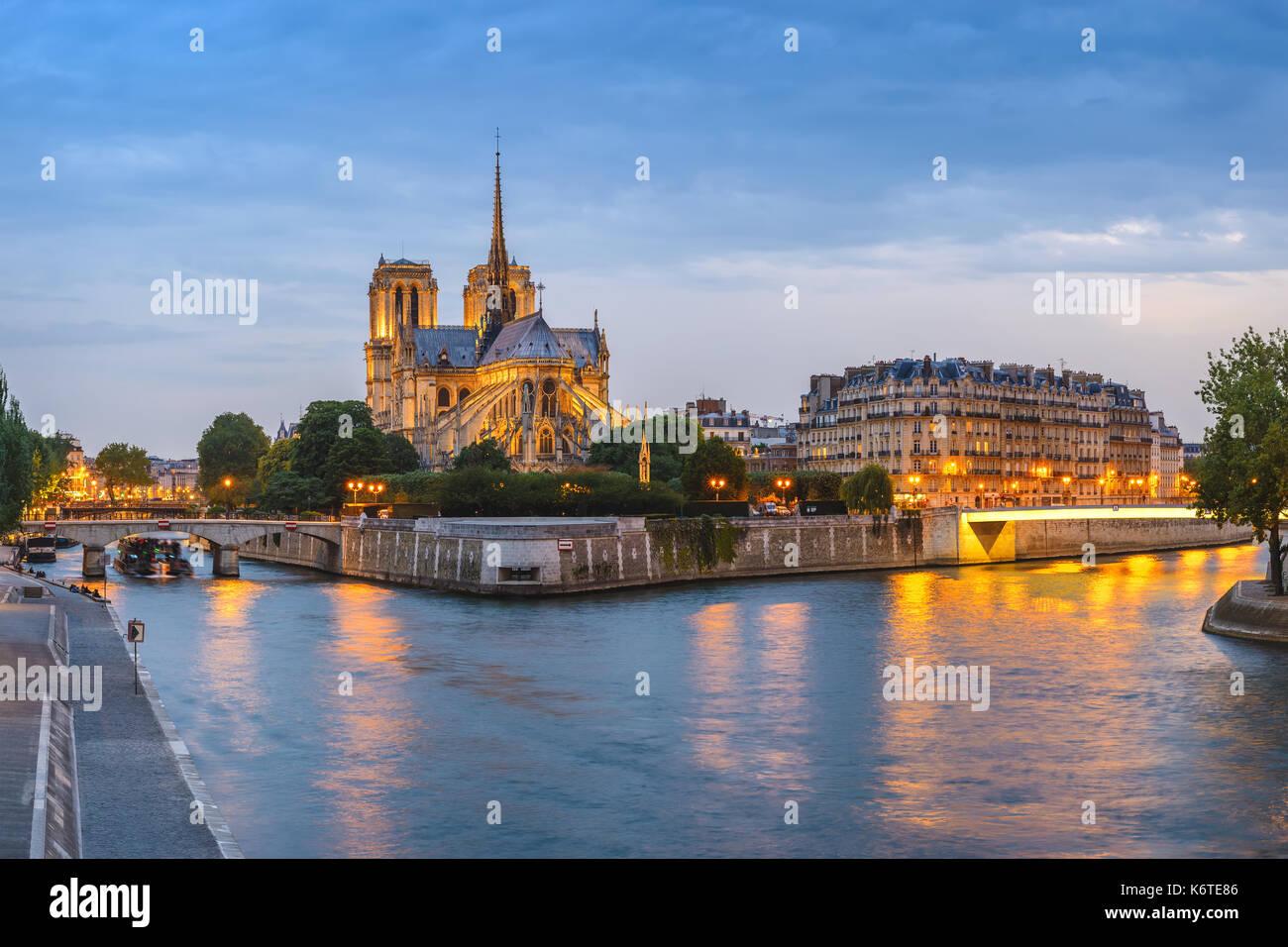 Paris sunset city skyline panorama at Notre Dame de Paris Cathedral and Seine River, Paris, France - Stock Image
