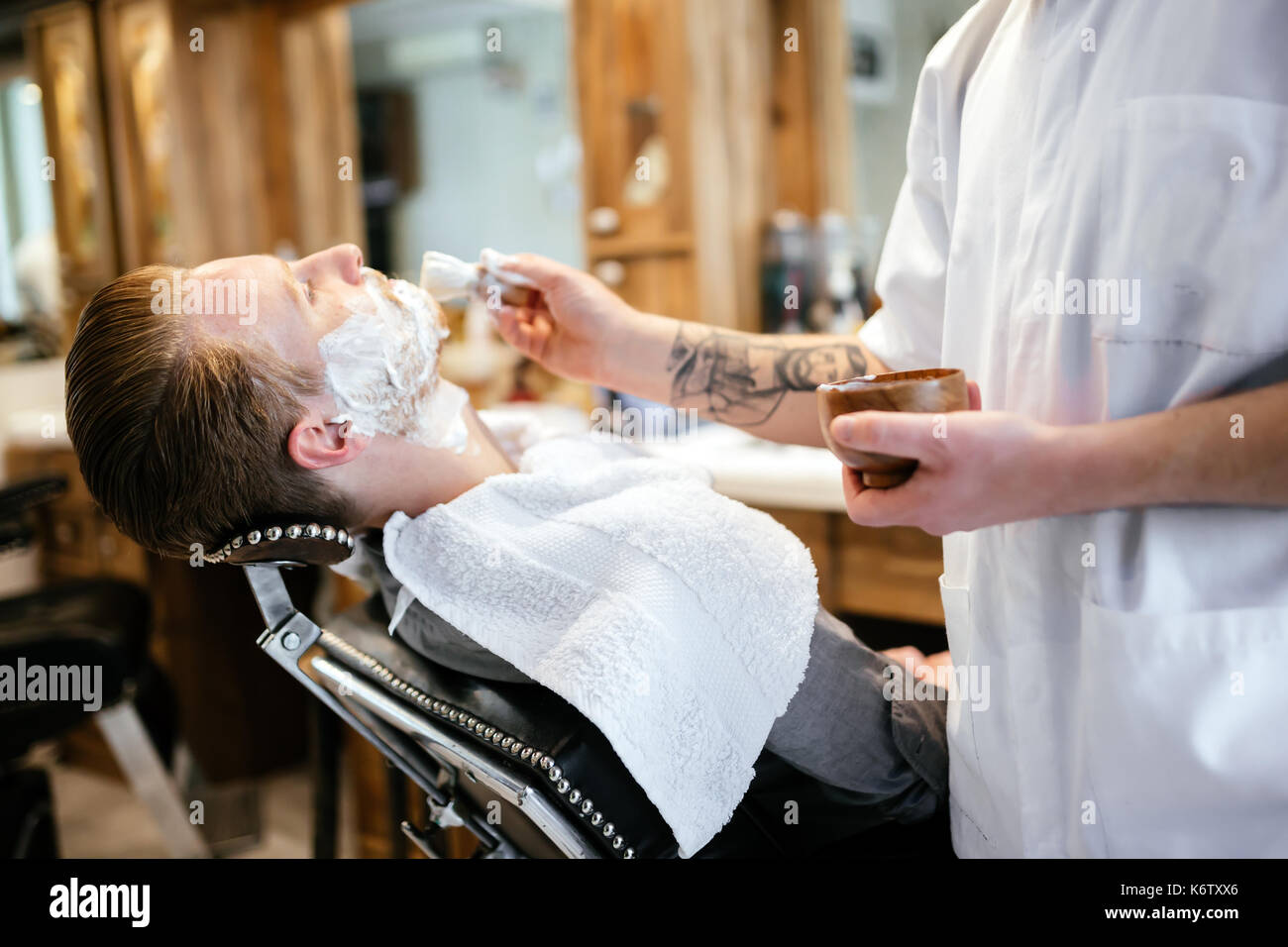 Male in barber shop - Stock Image
