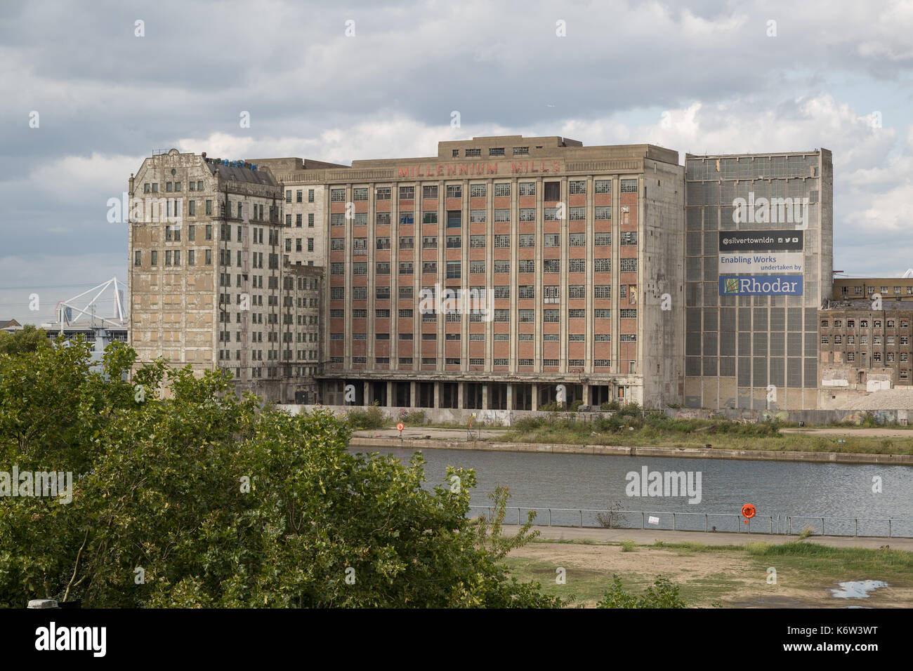 The derelict Spiller's Millennium Mills building at West Silvertown, East London, UK. - Stock Image