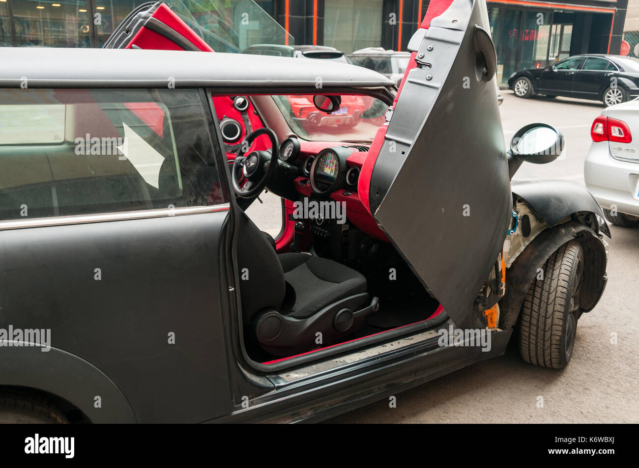 A modified Mini fitted with LSD hinges to give it scissor doors work done by Crazy Garage on the Beijing Tuning Street. & A modified Mini fitted with LSD hinges to give it scissor doors ...