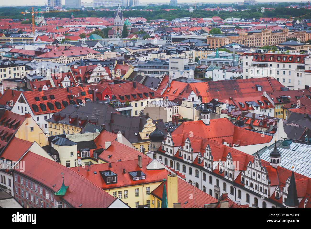 Beautiful super wide-angle sunny aerial view of Munich, Bayern, Bavaria, Germany with skyline and scenery beyond the city, seen from the height Stock Photo
