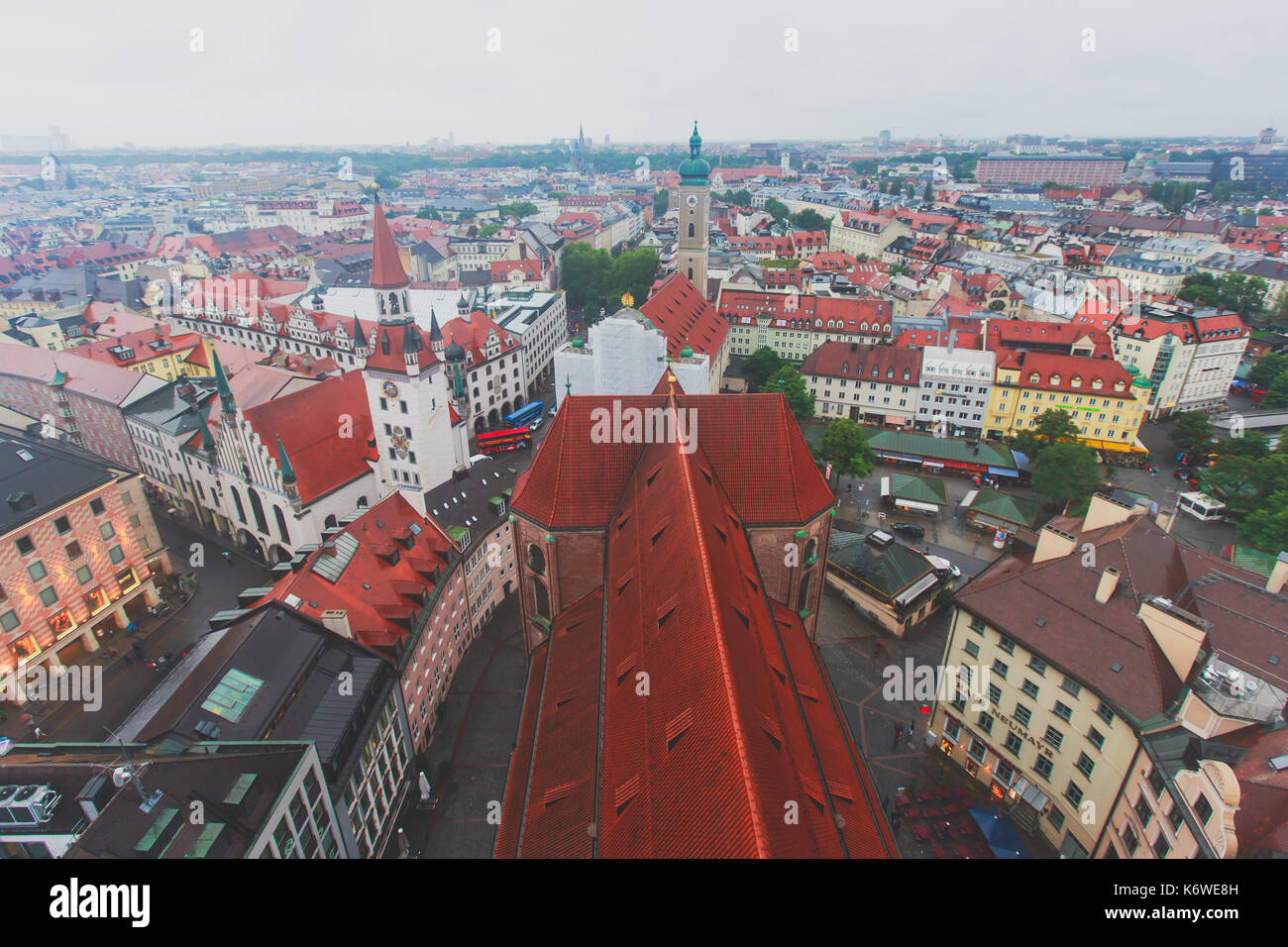 Beautiful super wide-angle sunny aerial view of Munich, Bayern, Bavaria, Germany with skyline and scenery beyond the city, seen from the height - Stock Image