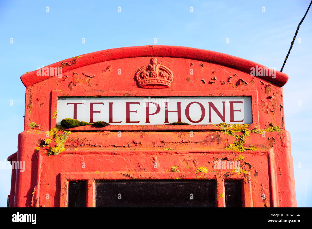 Public red Telephone box. K6 model showing Crown motif. Llansteffan. Wales. - Stock Image