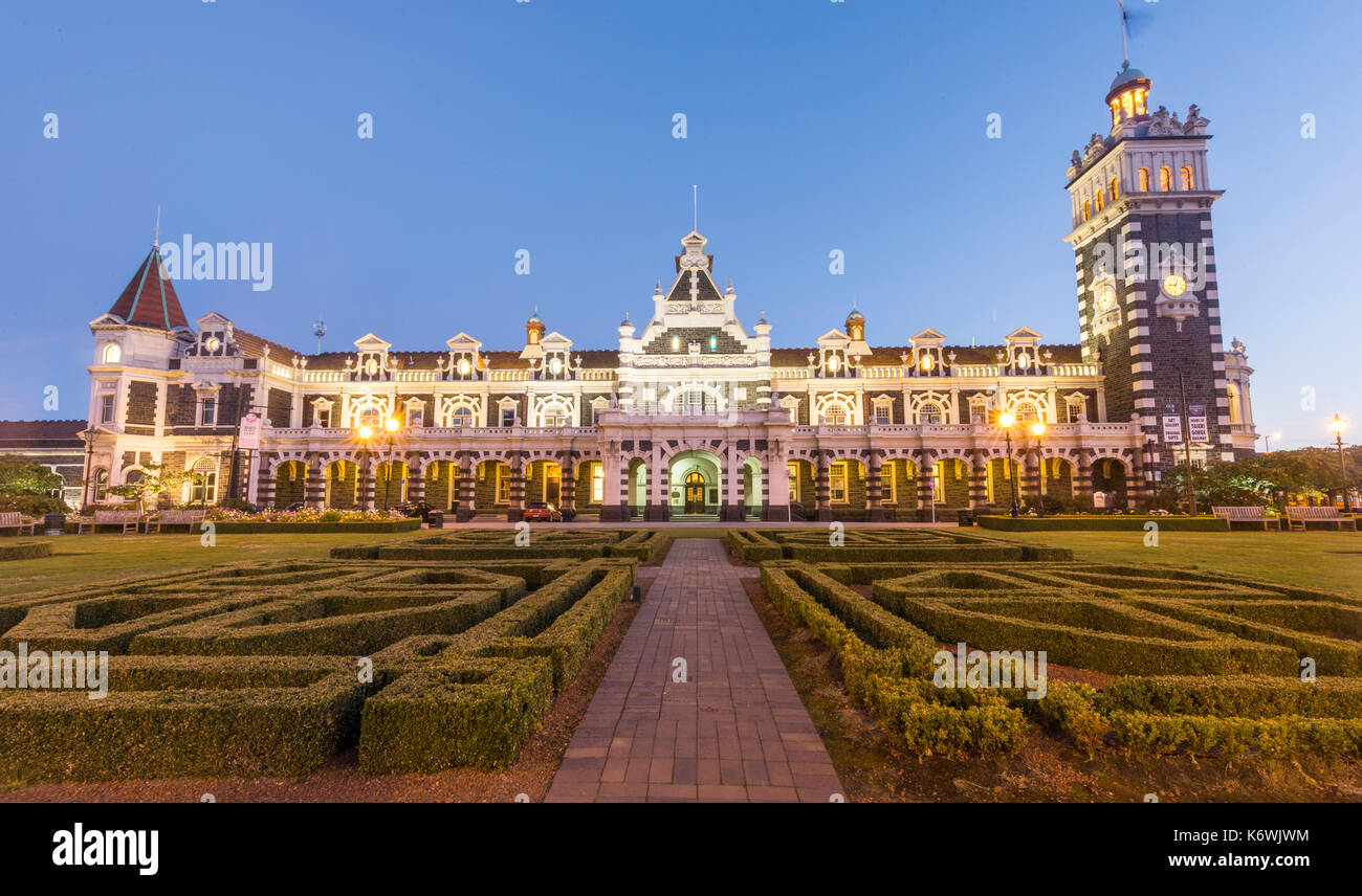Anzac Square and train station at night, Dunedin, Otago, South Island, New Zealand, Oceania - Stock Image