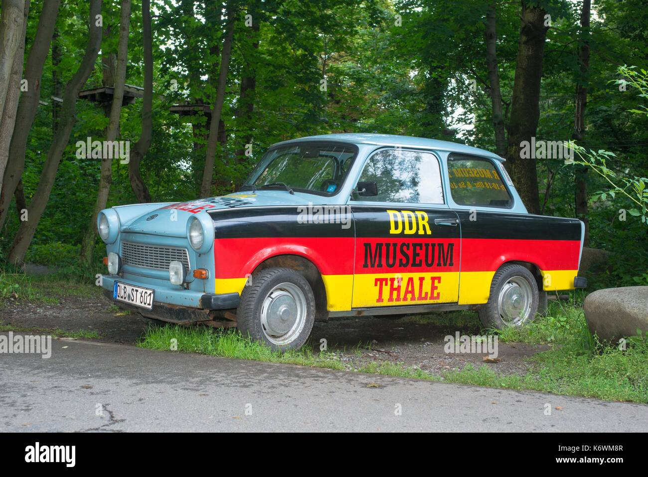 Old Trabant, Trabant at the roadside, varnished with Germany flag with inscription DDR-Museum Thale, advertising, Thale, Ostharz - Stock Image