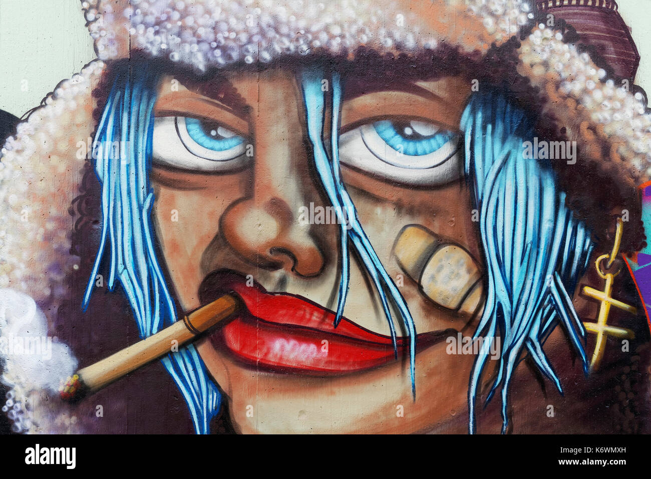 Face of a woman with cigarette and bandaid on cheek graffiti street art düsseldorf north rhine westphalia germany