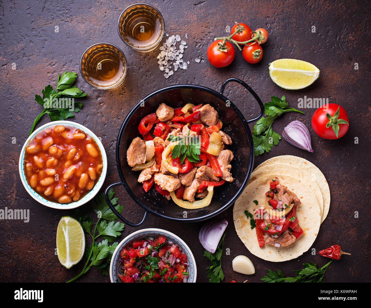Concept of Mexican food.  Salsa, tortilla, beans, fajitas and te - Stock Image