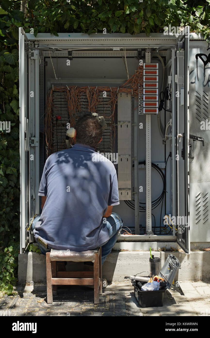 ATHENS, GREECE - AUGUST 1, 2017: Telephone technician