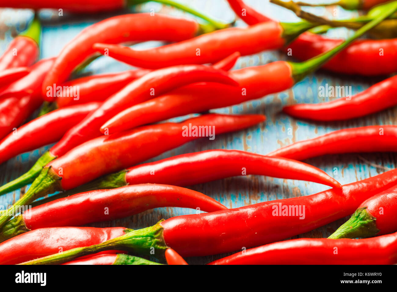 Hot red chili pepper  on a old blue color wooden table with place copy space for text. Stock Photo