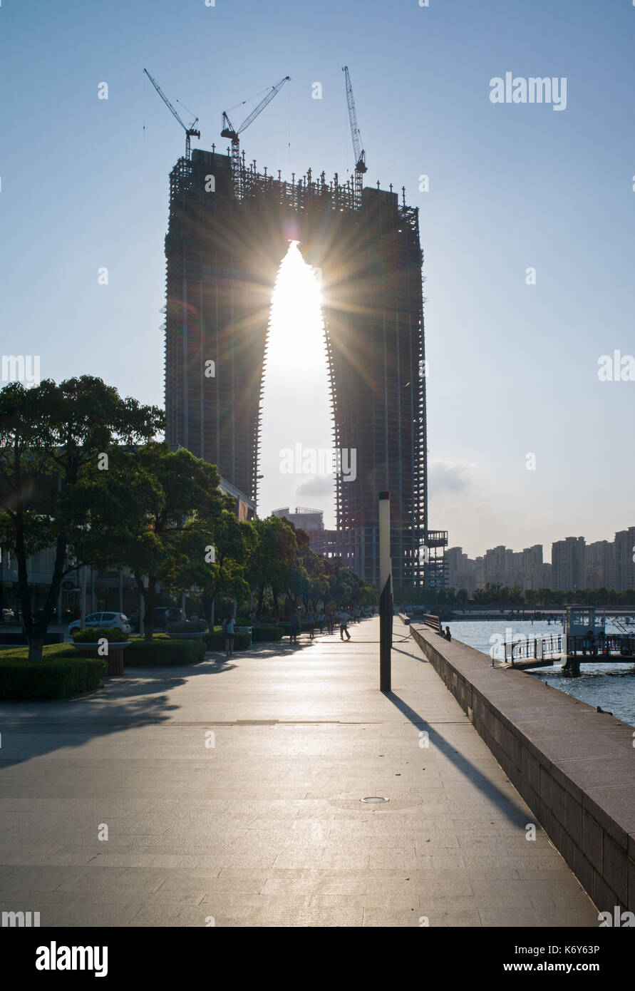 Gate of the Orient ('Pants') building under construction at Dongfangzhimen, Suzhou, China - Stock Image