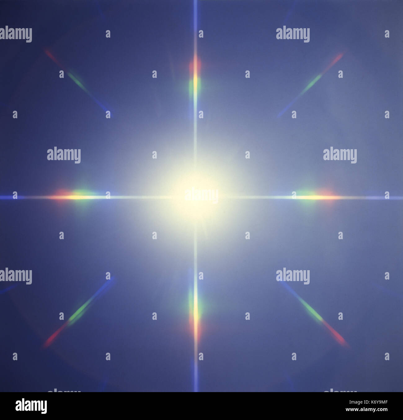 Star pattern with diffraction rainbow spectrum colors - Stock Image