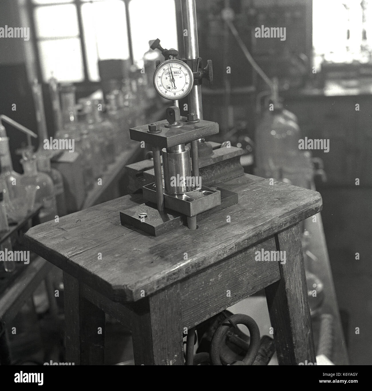 Early 1950s, research into the properties of natural fibres, picture shows the apparatus used to measure the swelling of sisal fibres, Leeds University, Leeds, England, - Stock Image
