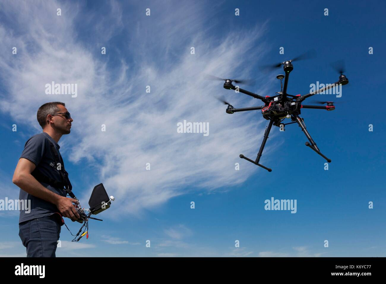France, Bouches du Rhone, professional pilot of a drone or teleopilot in training with a certified DJI S900 hexacopter drone able to embark photo or video equipment (Model Release ok) - Stock Image