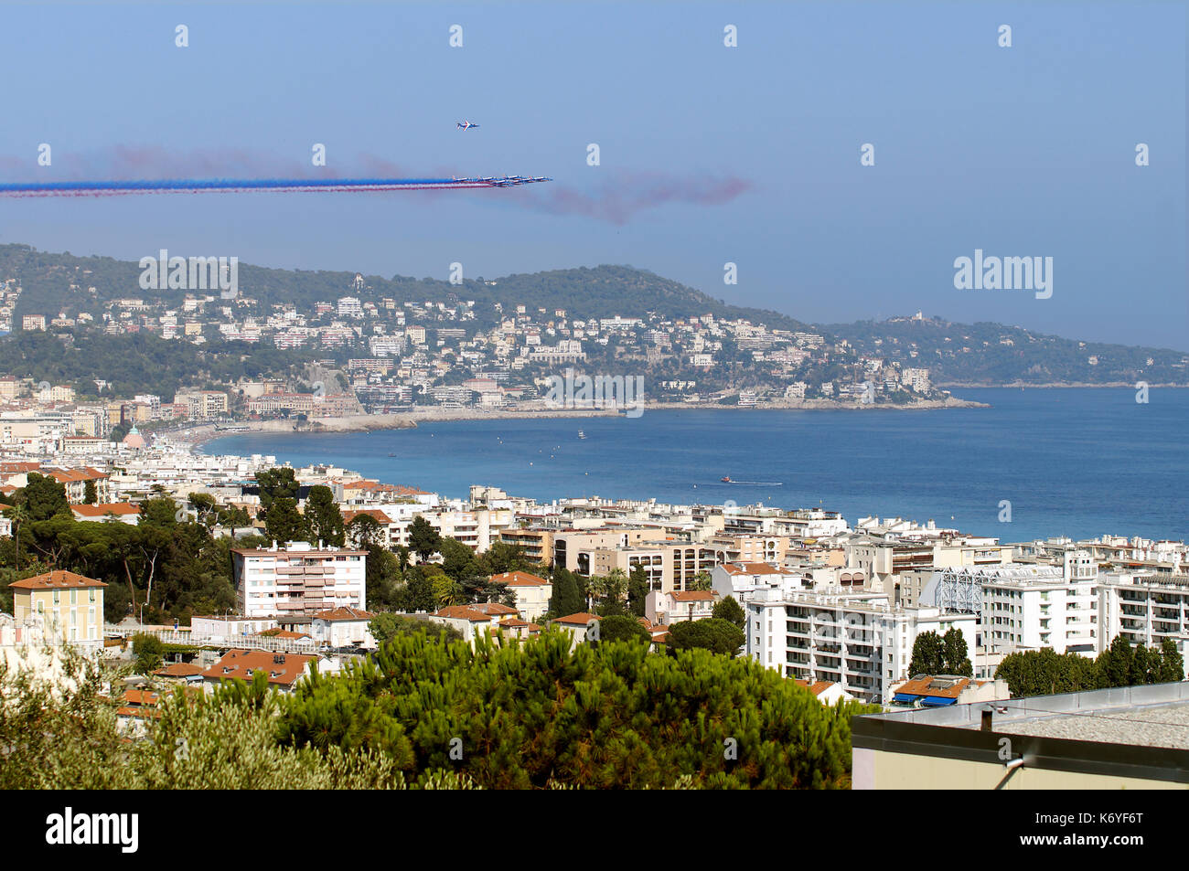 NICE - JULY 14, 2017 :  France commemorates Bastille Day attack in Nice. French Acrobatic Patrol over the city - Stock Image