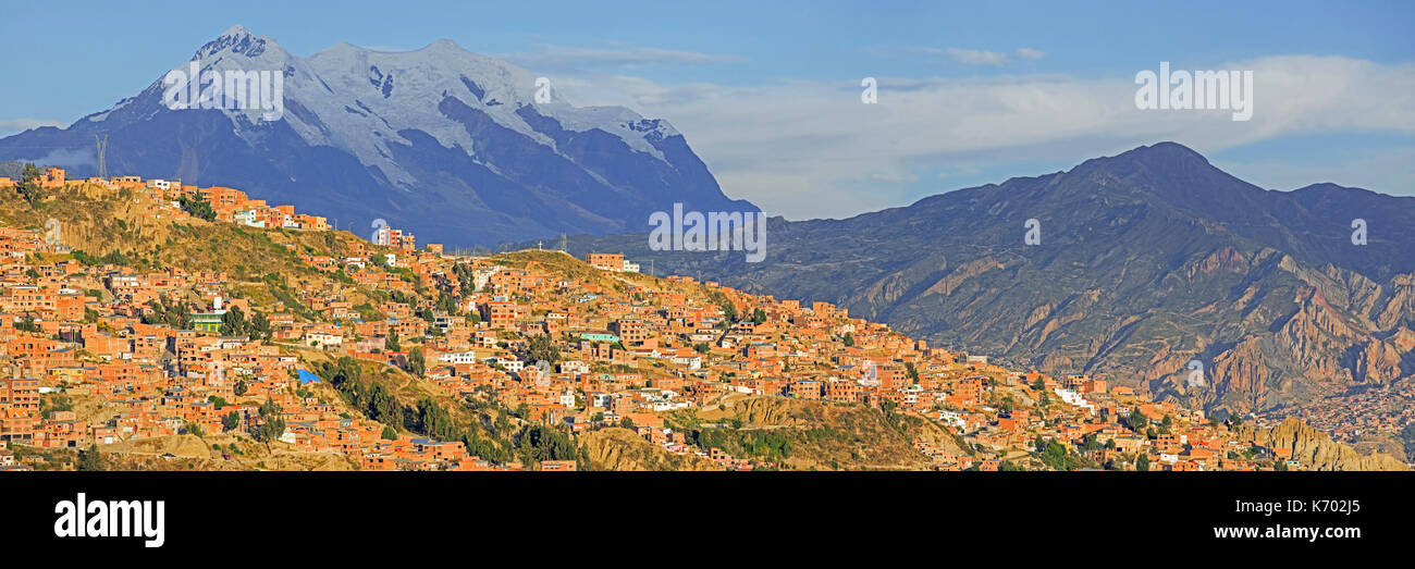 Mount Illimani, at 6.438 meter the highest mountain in the Cordillera Real, towering over the city La Paz, Bolivia - Stock Image