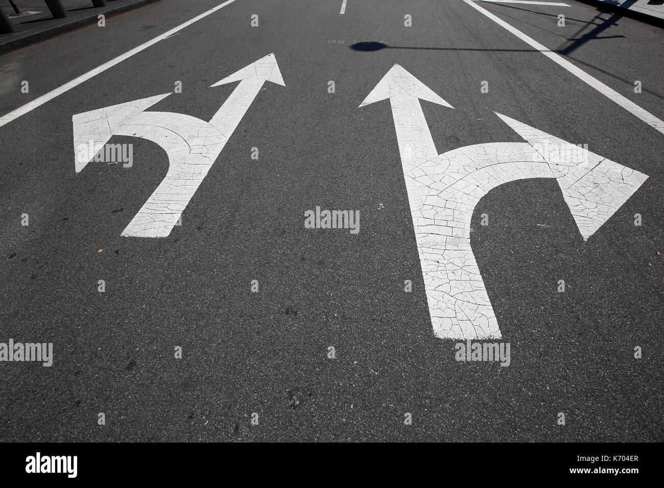 painted traffic signalization on street - Stock Image