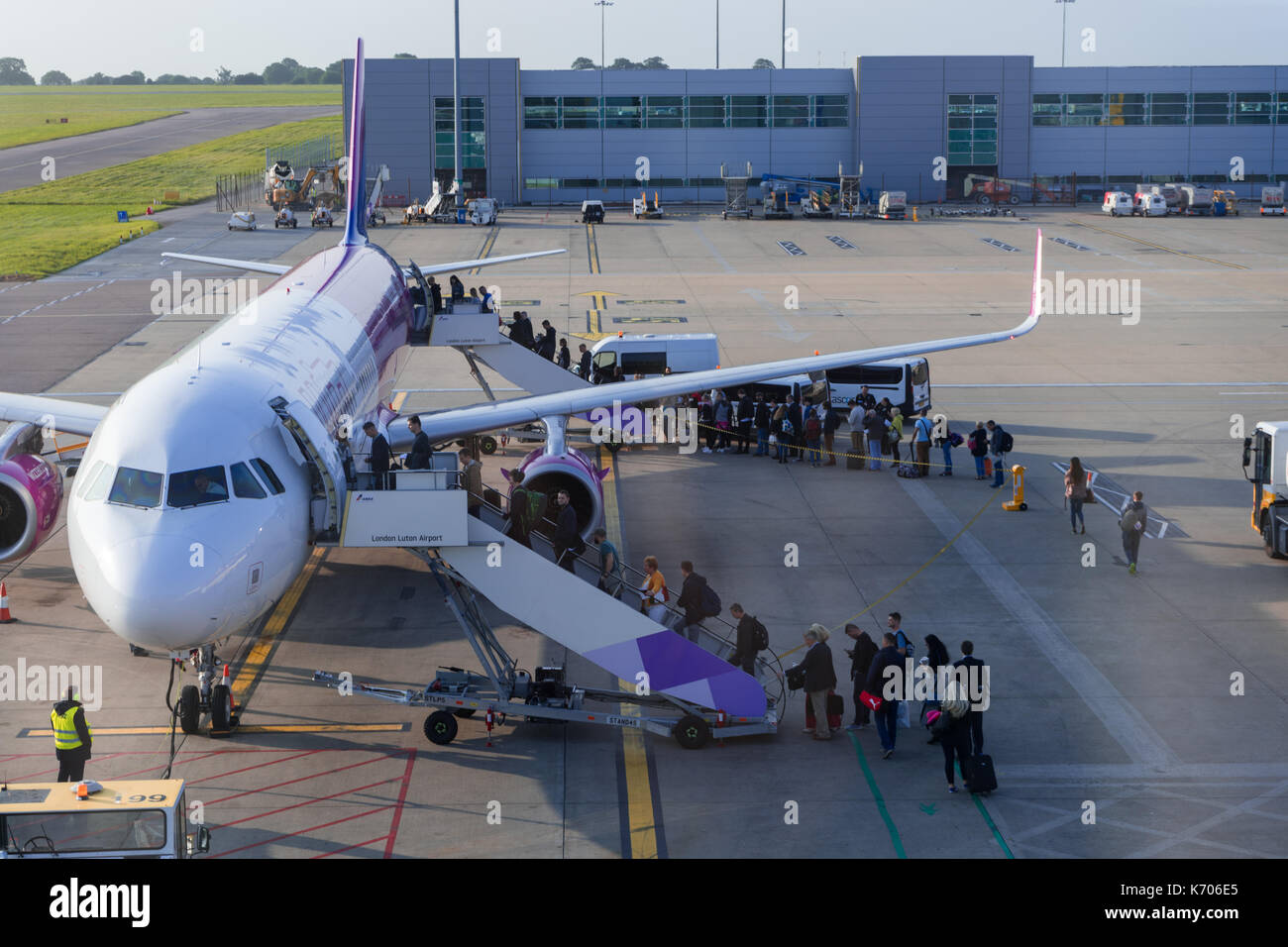 Passengers Boarding A Wizz Air Airplane At London Luton Airport In Stock Photo Alamy