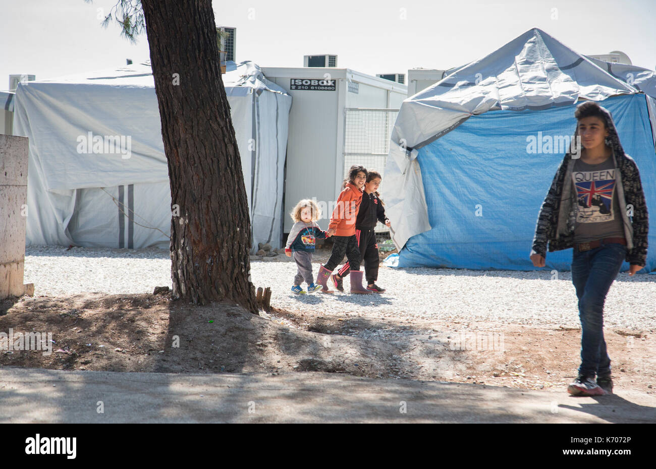 Young children walk confidently within the Ritsona Refugee Camp - Stock Image