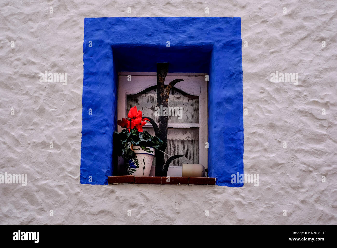 windows with flowers in Sitges village, district of Barcelona, good summer escape, beach, fun and architecture, Stock Photo
