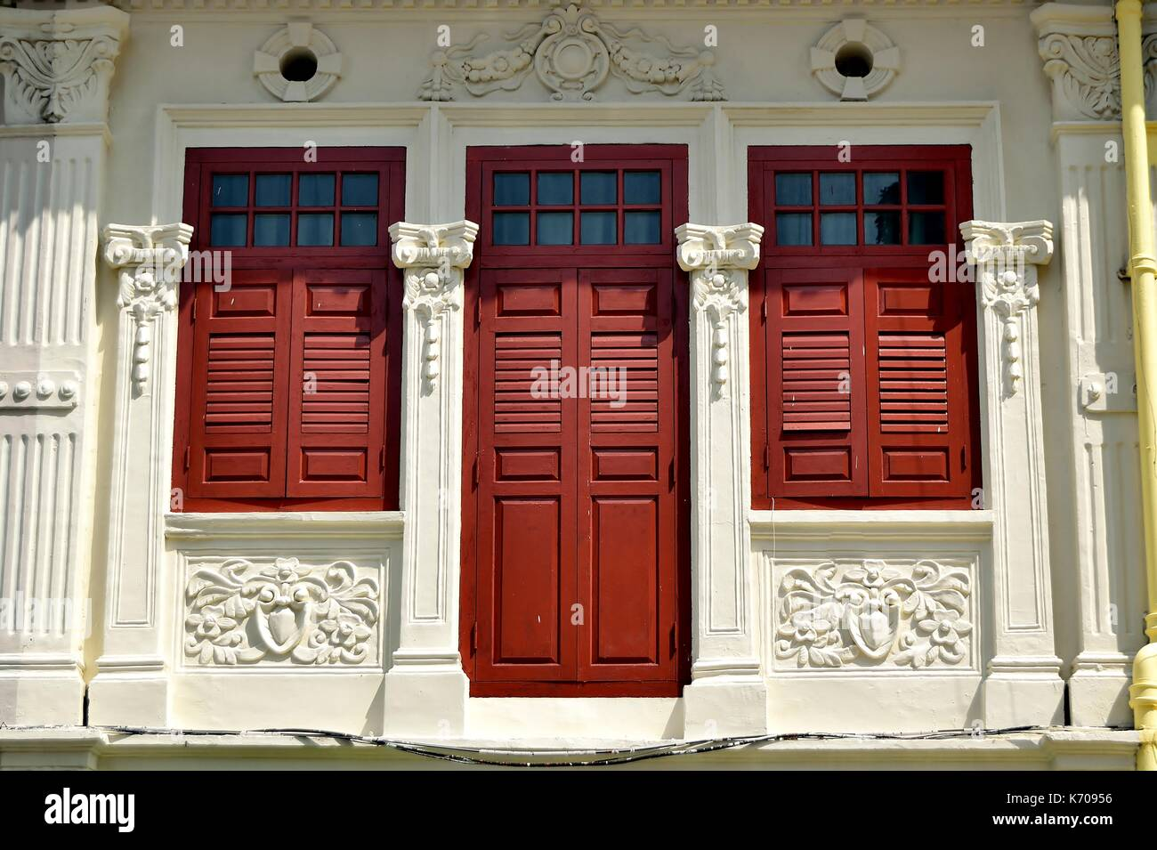 Traditional Shop House Exterior With White Facade Red Wooden Stock
