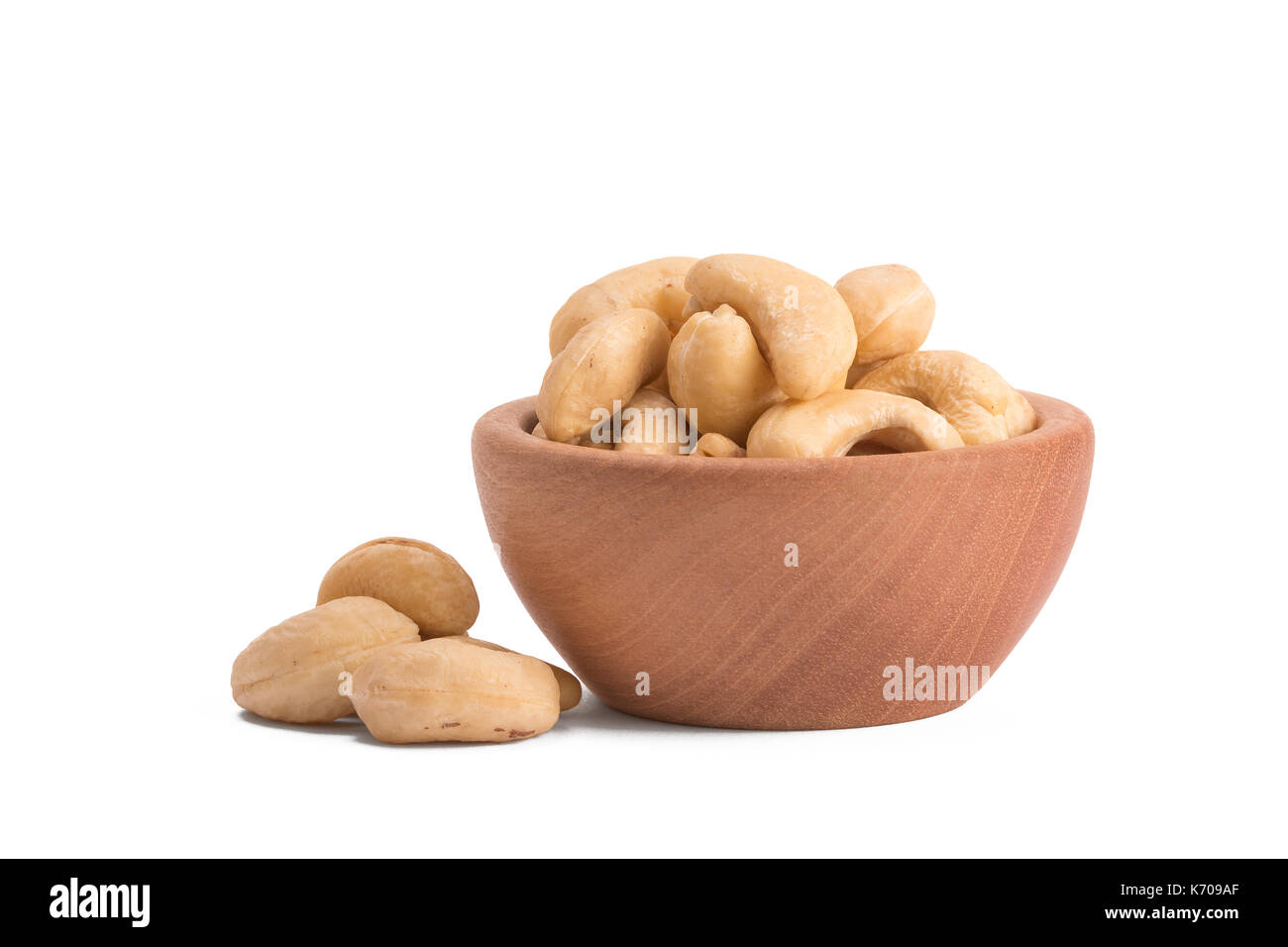 Bowl with cashews on a white background. Stock Photo