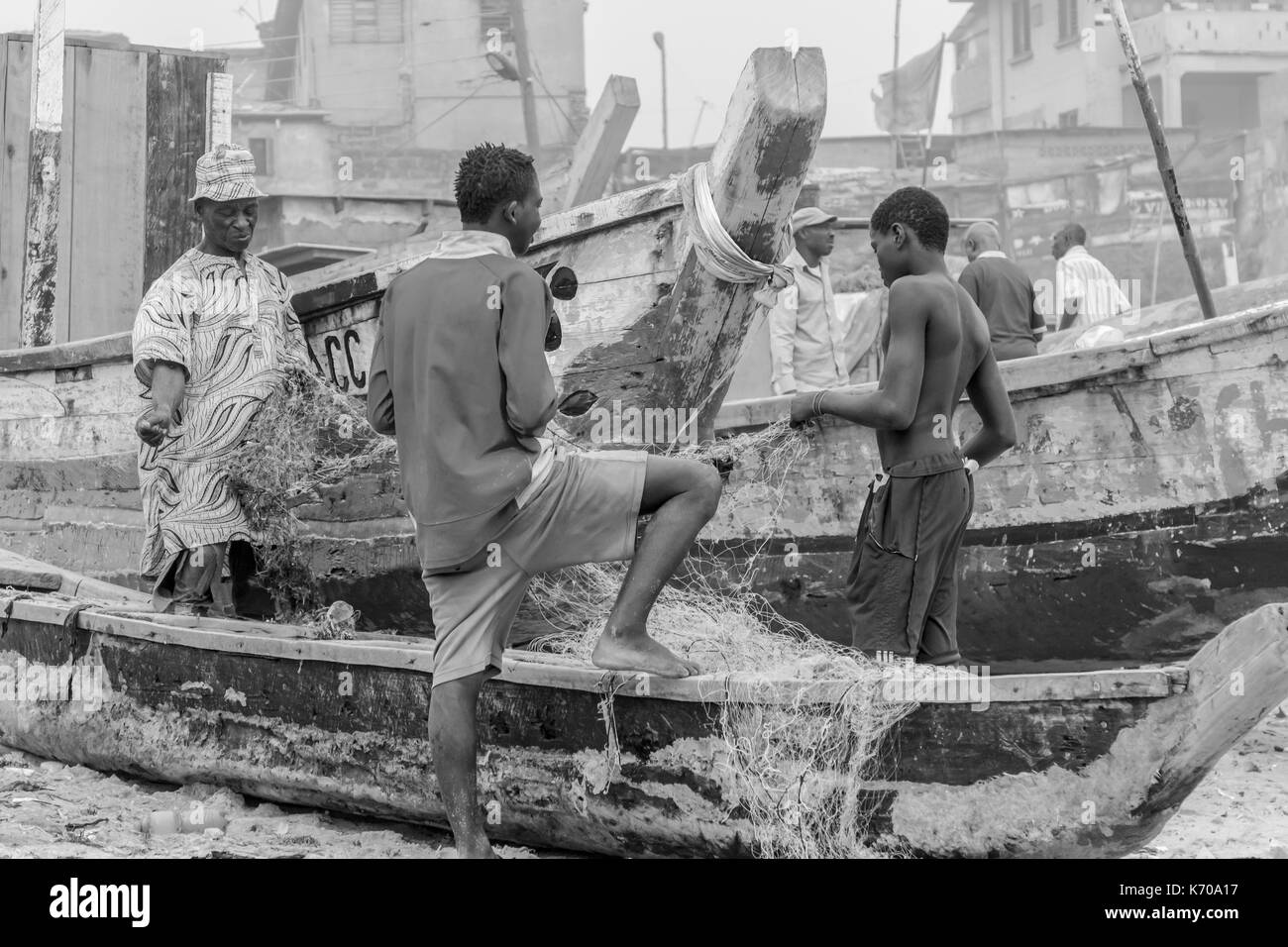 Ghana - December 28, 2016: Fishermen set up networks after fishing - Stock Image