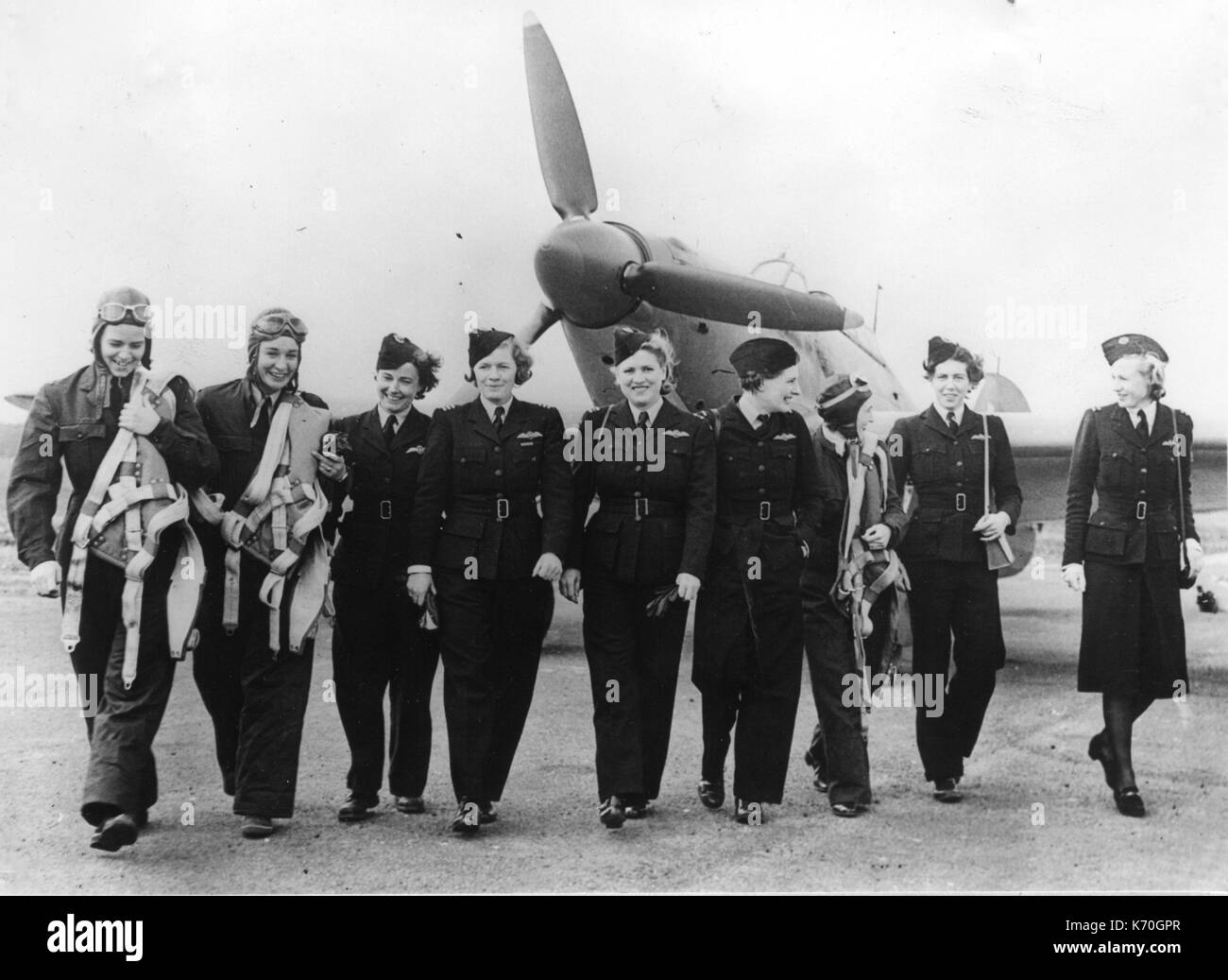 AMERICAN WOMEN WHO FLY WARSHIPS TO THE MEN WHO FLY THEM AGAINST AXIS -- Women of the United Nations -- U.S. and British members of the A.T.A., ready to take up Hurricane fighter places for delivery to R.A.F. pilots. June 13, 1942. - Stock Image