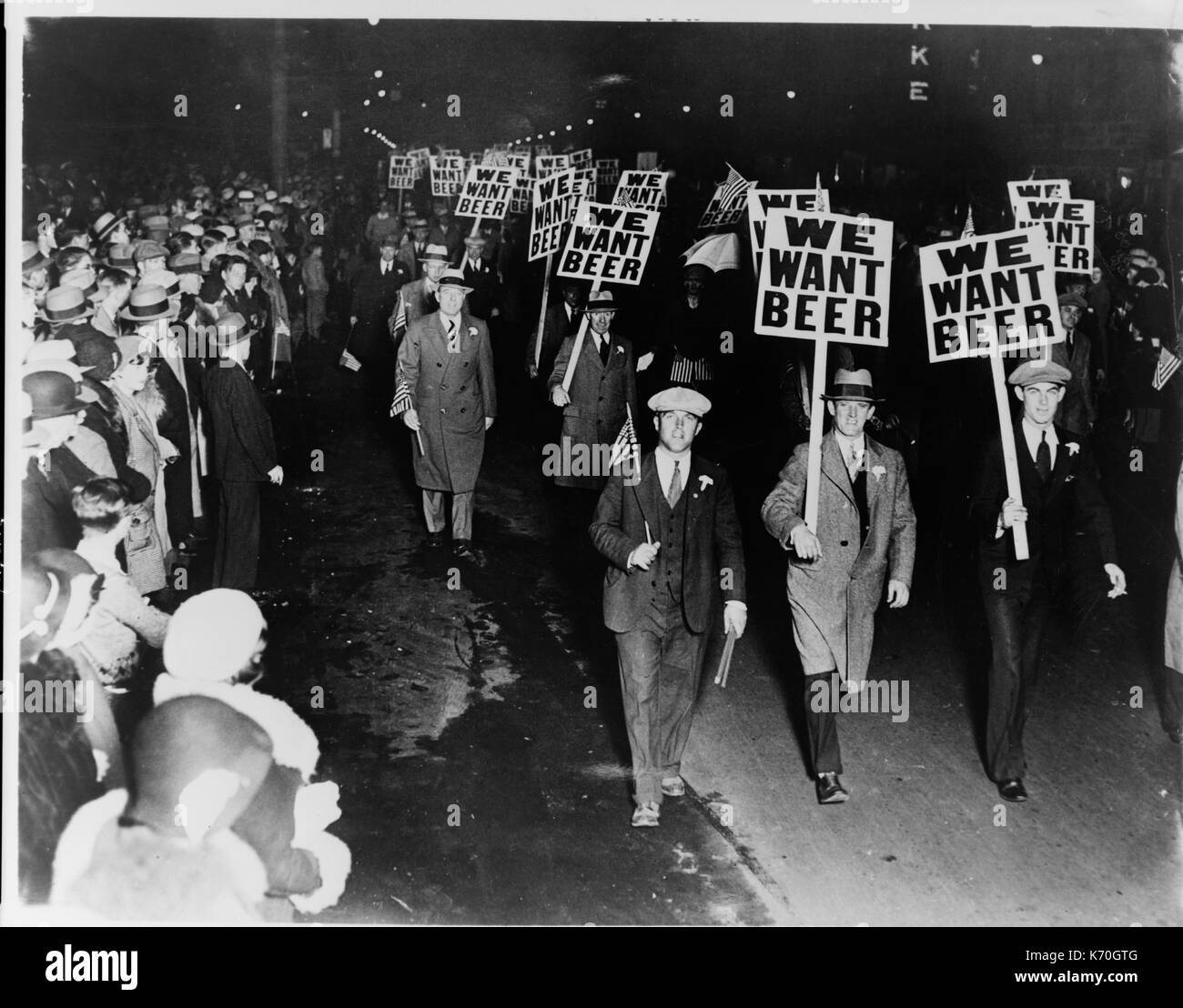 Labor union members marching through Broad Street, Newark New Jersey, carrying signs reading 'We want beer' in protest of prohibition. 1931, October 31. - Stock Image