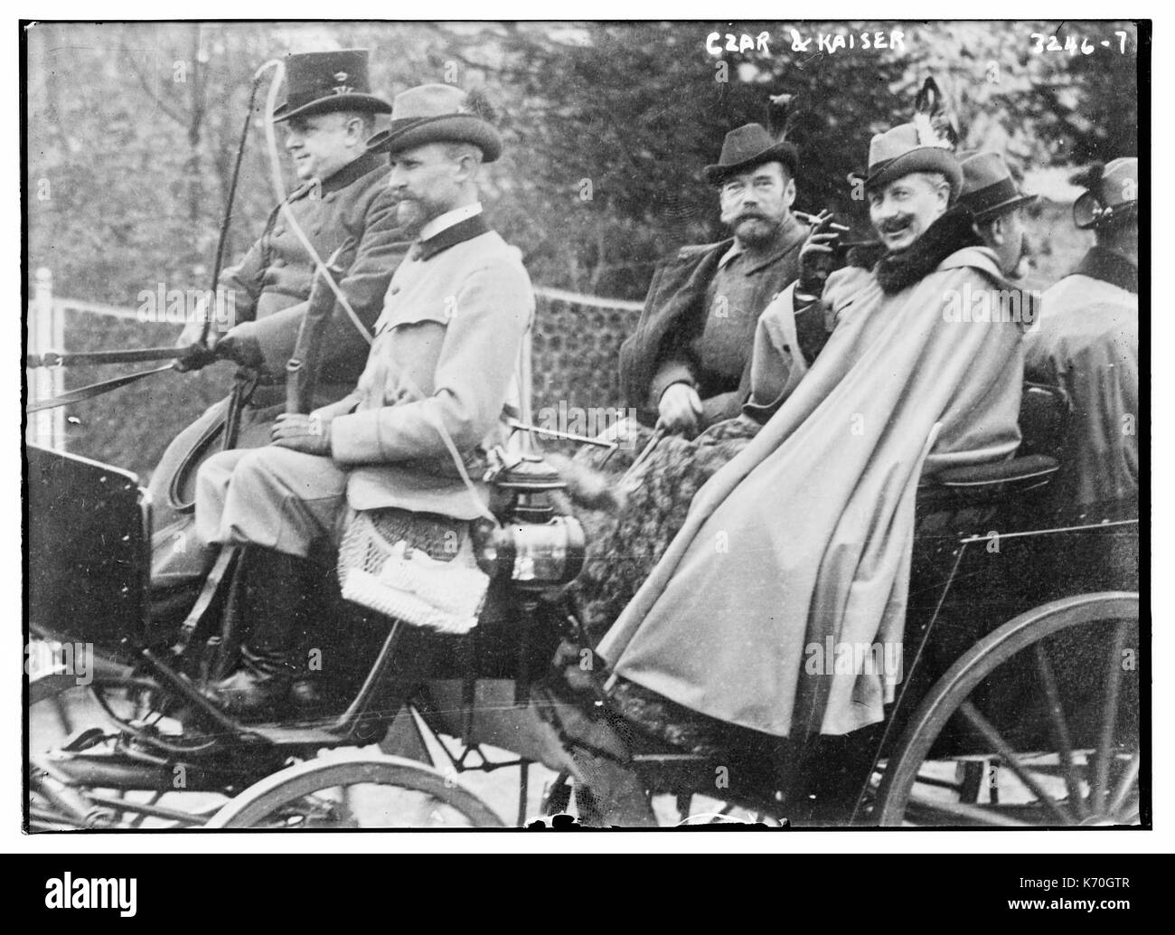 Royal cousins Czar Nicholas of Russia (middle seat, left) and Kaiser Wilhelm II of Prussia (holding cigarette) enjoy a carriage ride together. Possibly 1913. - Stock Image