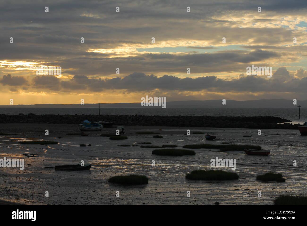 Stranded boats in Morecambe Bay at low tide Stock Photo