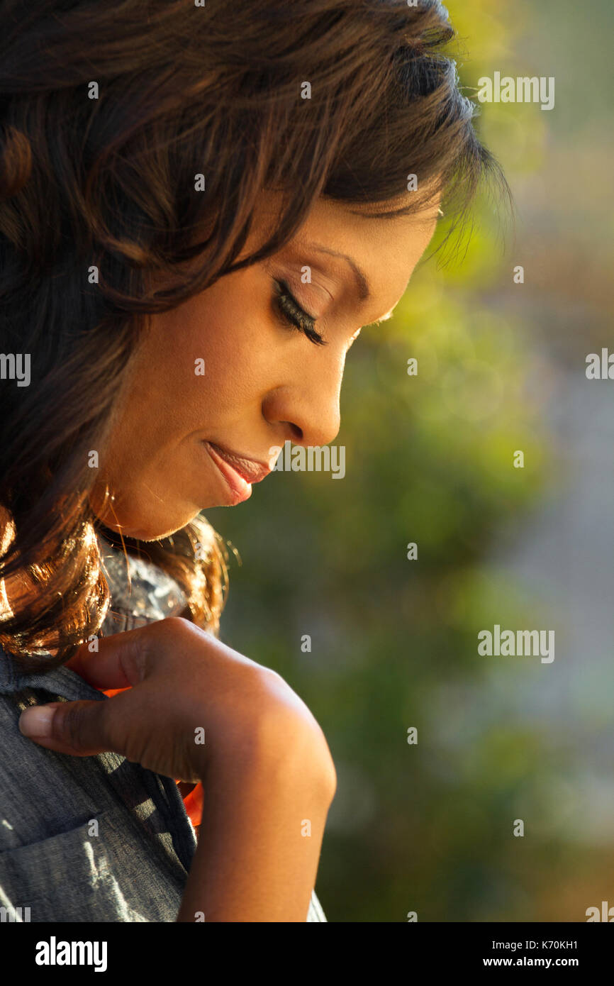 Closeup of a woman praying. - Stock Image