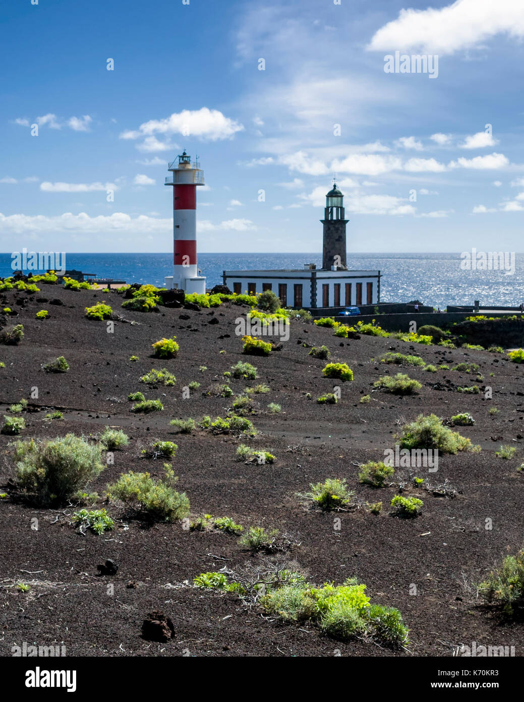 Fuencaliente, La Palma. Canary Islands Spain.  The Fuencaliente lighthouse is an active lighthouse on the island of La Palma in the Canary Islands. It is the second lighthouse to be built at this site, which marks the southern end of the island.    The old original lighthouse can be seen in the background.  The visitor centre was built to promote and educate people about the marine environment.  Photographed with a Ricoh GRII camera. - Stock Image