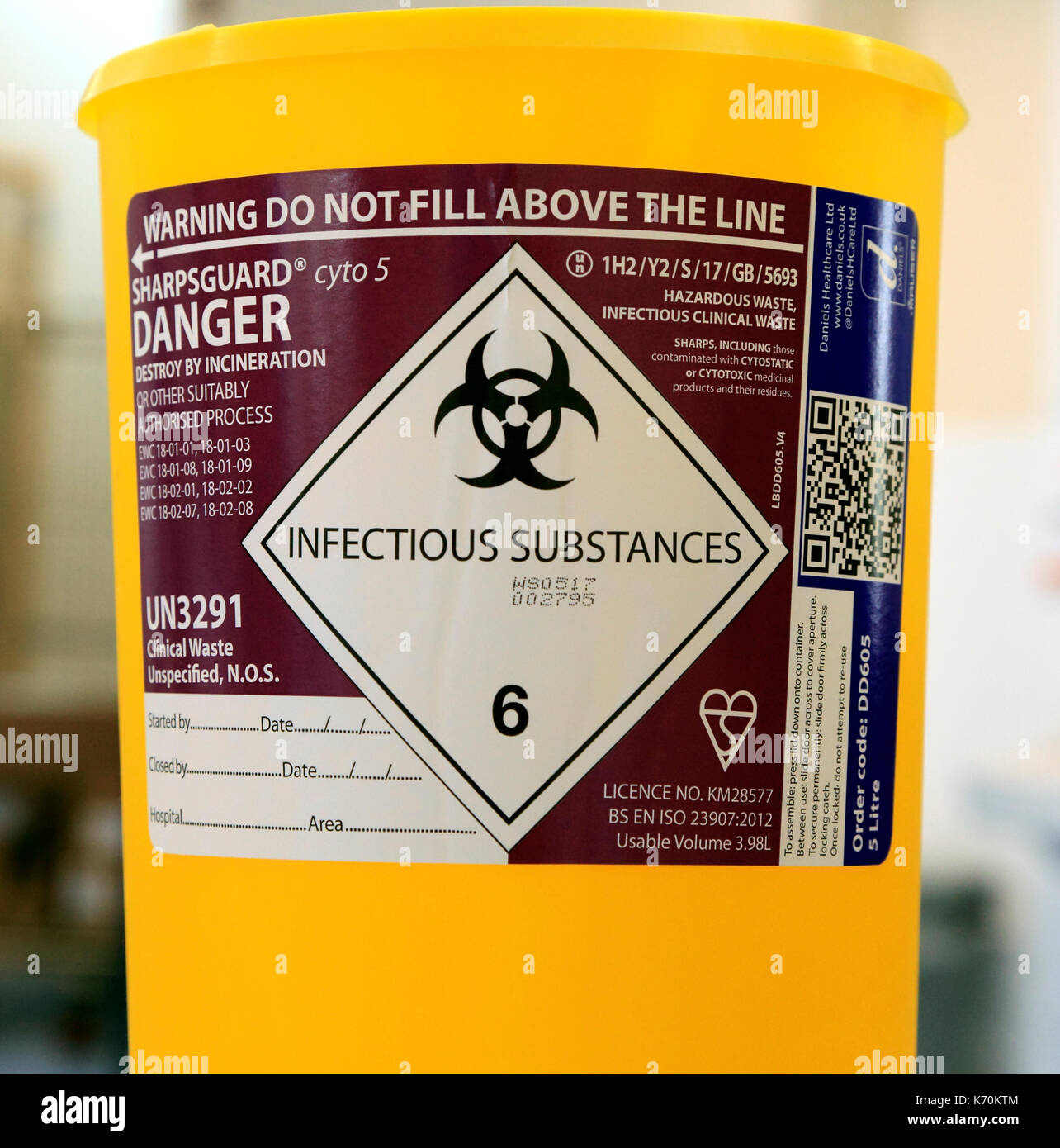 Infectious Substances, container, health, hazard,  destroy by incineration, hospital, medical, safety, England, UK - Stock Image