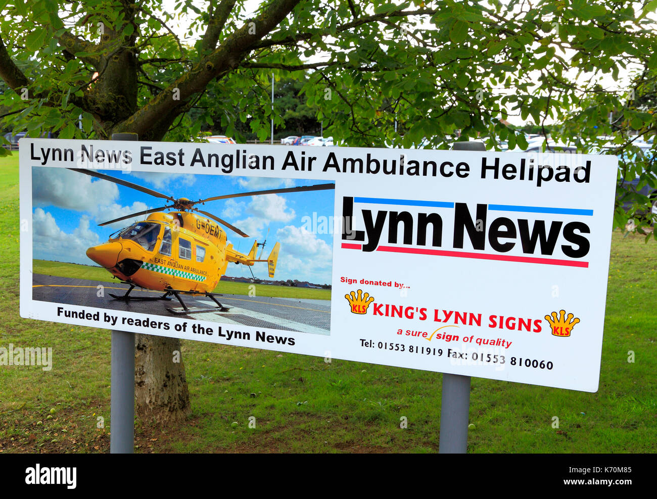 Queen Elizabeth Hospital, Helicopter, Helipdad, Air Ambulance Service, Kings Lynn, Norfolk, England, UK sign, sponsored by Lynn News - Stock Image