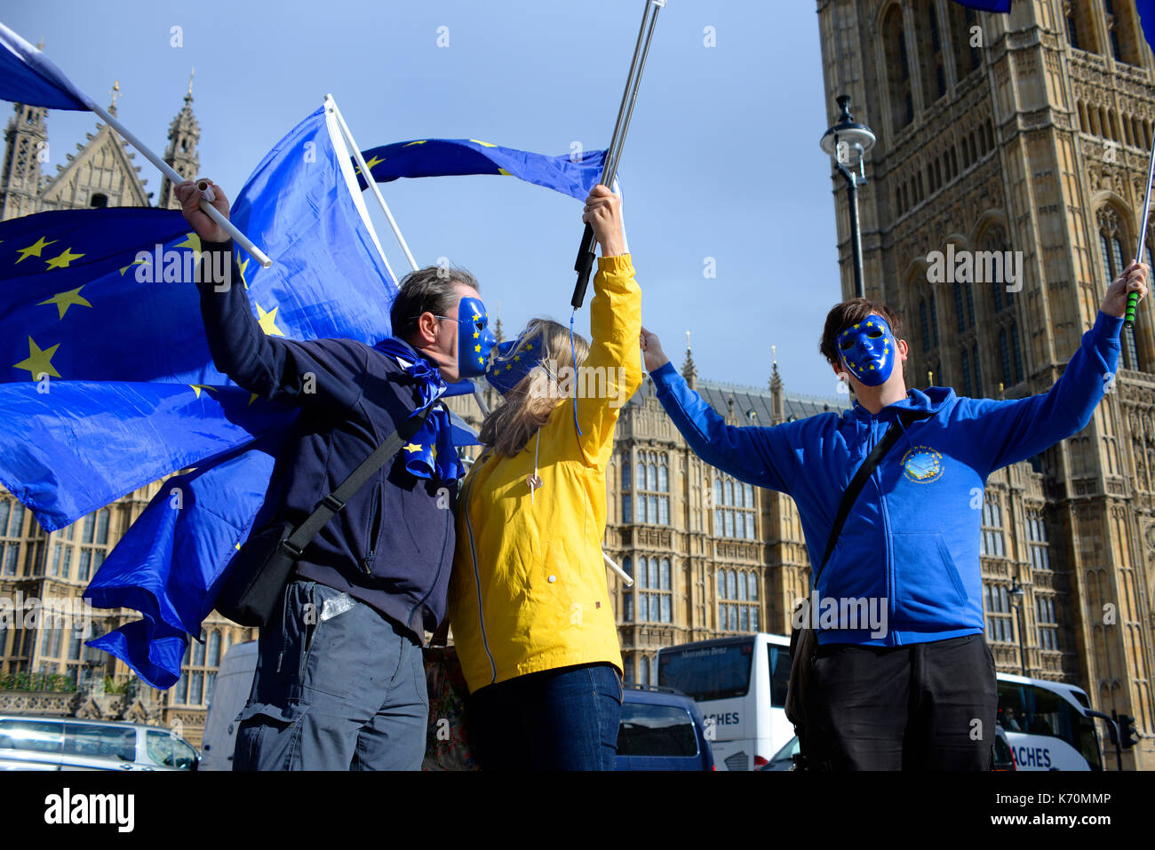 Pro Europe remainers anti brexit protesters waving European flags outside Houses of Parliament Palace of Westminster London. Space for copy - Stock Image