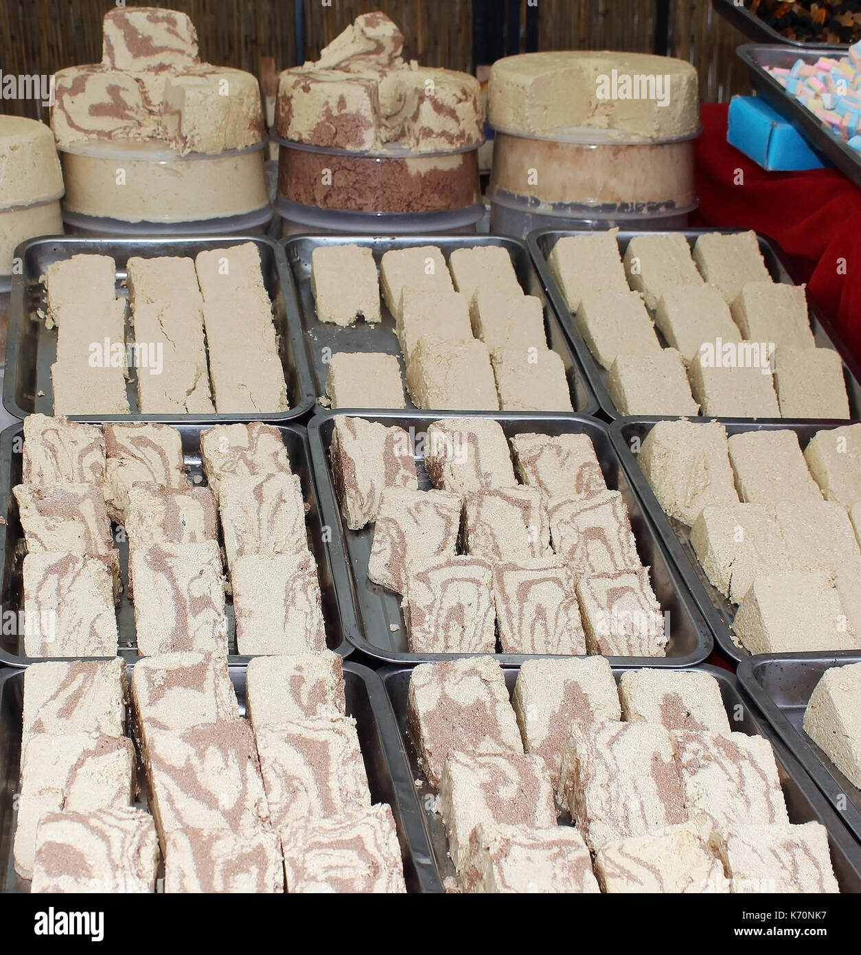 Traditional Turkish confectionery halvah on market stall - Stock Image
