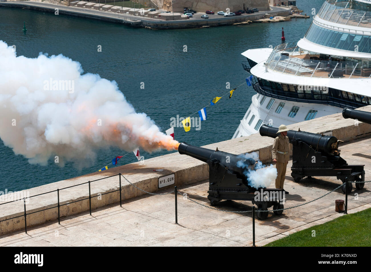 The noon cannon being fired from the Saluting Battery in Valletta, the capital of Malta. - Stock Image