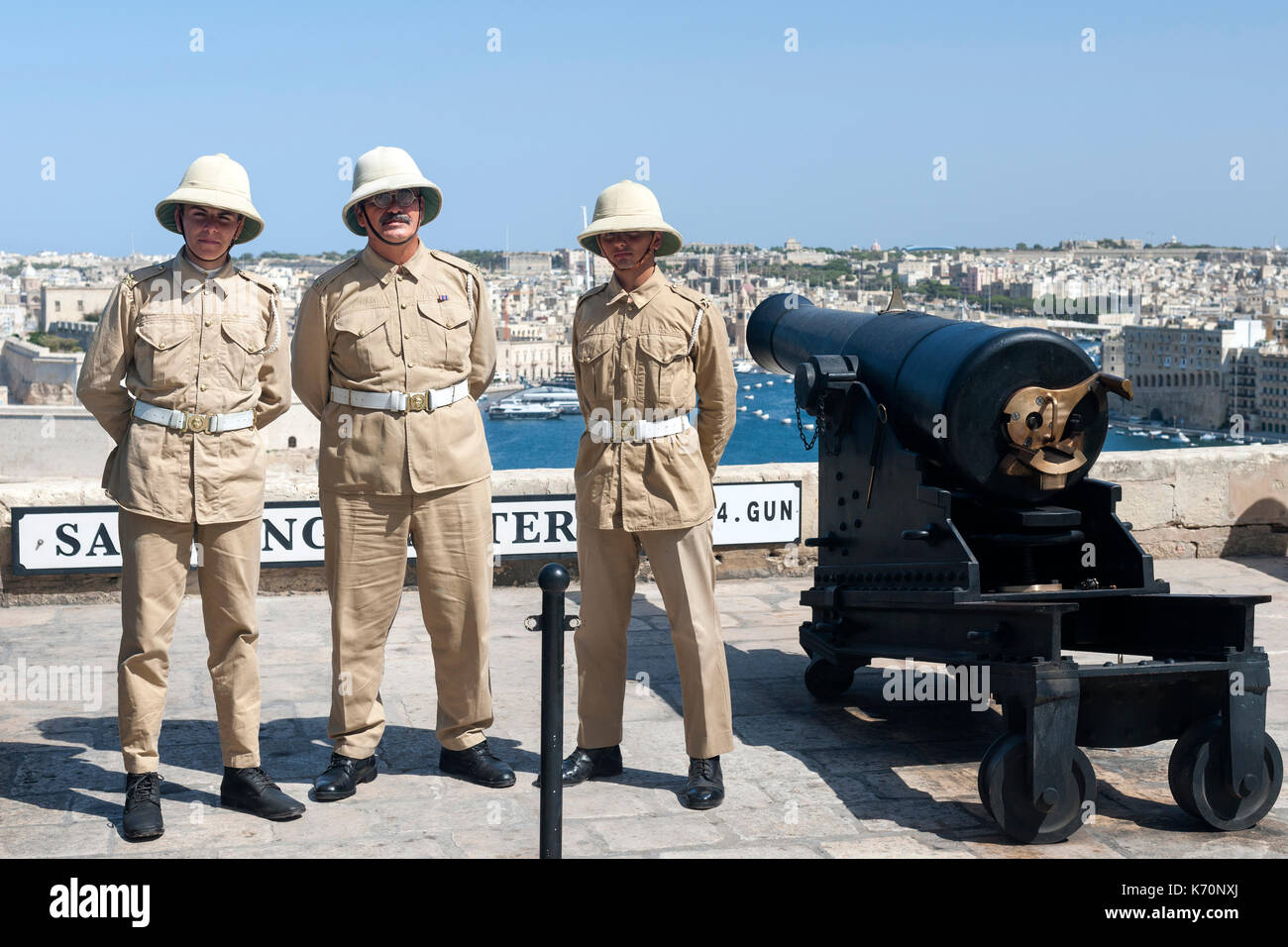 Uniformed personnel of the the Saluting Battery in Valletta, the capital of Malta. - Stock Image