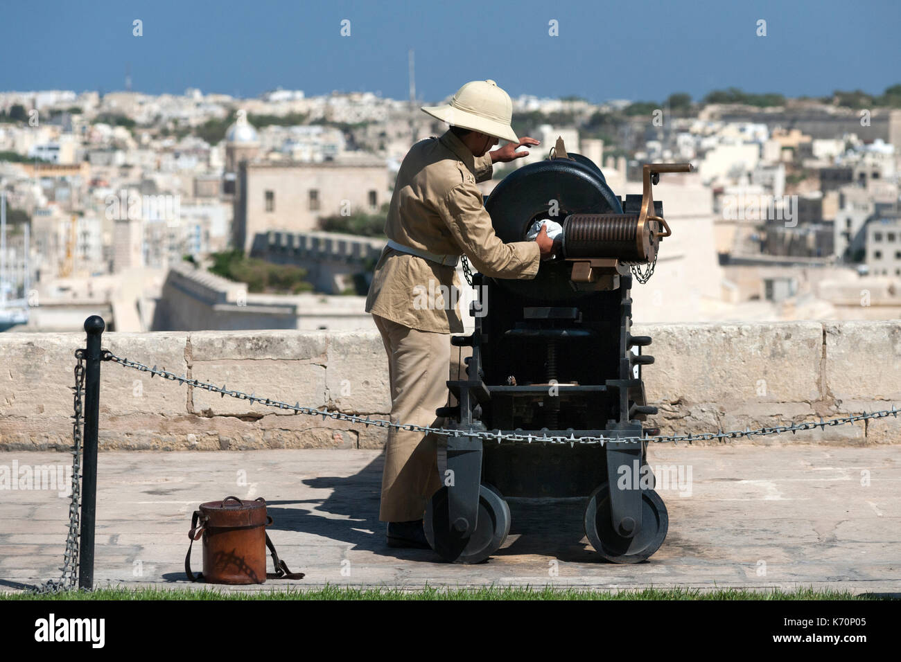 The noon cannon being prepared for firing at the Saluting Battery in Valletta, Malta. - Stock Image