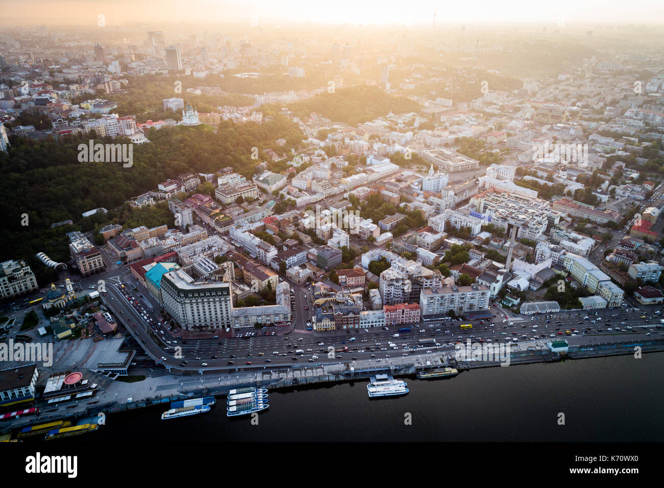 Panoramic view of a modern city at sunset. Postal square, Podol district, city center of Kiev, Ukraine. Aerial view - Stock Image