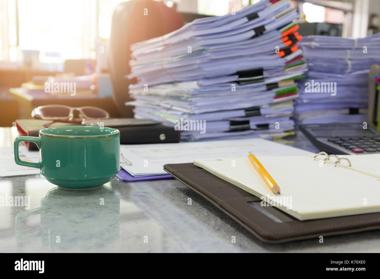 Concept of document workload, Pile of unfinished documents on office desk, Stack of business paper - Stock Image