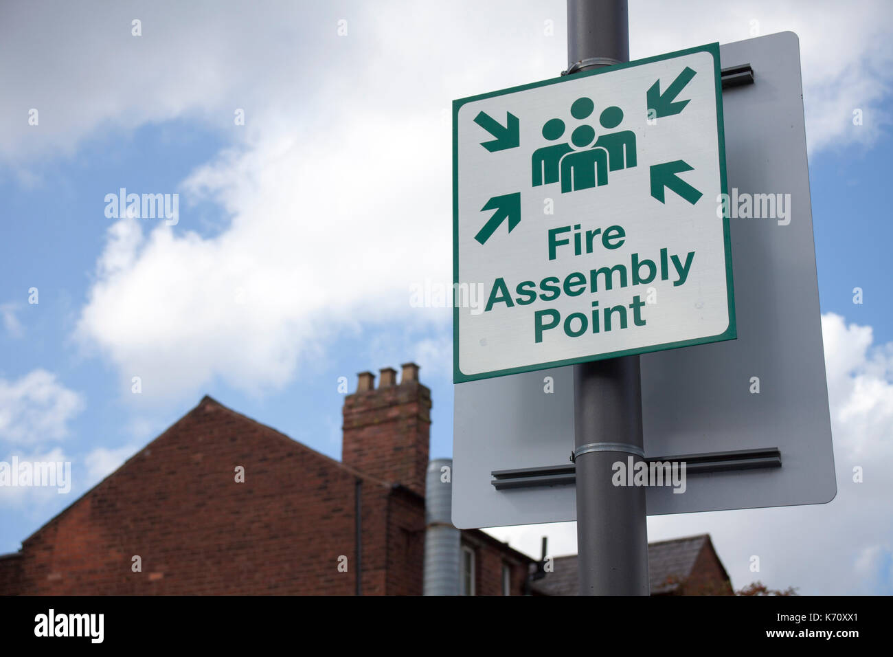 Sign fire assembly point on the street. - Stock Image