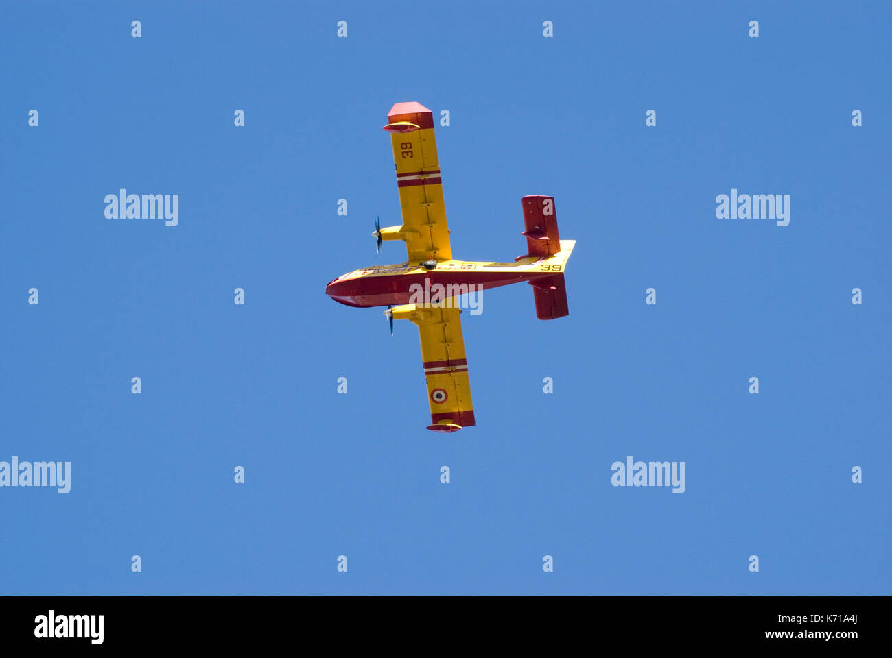 Canadair CL-415 of french aerial firefighting task force in operation during forest fire - Stock Image